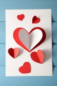 Post card with paper hearts — Stock Photo