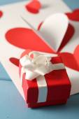 Paper hearts and gift box — Stock Photo