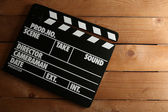 Movie clapper on wooden background — Stock Photo