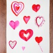 Painted hearts on sheet — Stock Photo #64268377