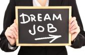 Young businesswoman holding blackboard with Dream Job text on it — Stock Photo