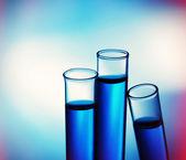 Test-tubes on bright background — Stock Photo