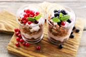 Healthy layered dessert with muesli and berries on table — Photo