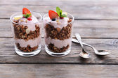 Healthy layered dessert with muesli and berries on table — Fotografia Stock