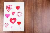 Painted hearts on sheet — Stock Photo