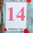 Valentines Day, February 14 on calendar on wooden background — Stock Photo #64273573