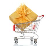 Small shopping cart with present box isolated on white — Stock Photo