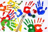 Hand prints of paint — Stock Photo