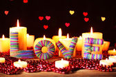 Romantic gift with candles on lights background, love concept — Stock Photo