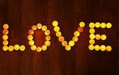 Word LOVE  burning candles — Stok fotoğraf
