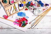 Professional art materials on color wooden background — Stok fotoğraf