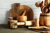 Wooden utensils on wooden table and color planks — Fotografia Stock