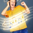 Young man with headphones listening music on grey background — Stock Photo #64350123