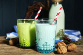 Fresh milk with natural decor, on wooden background — Zdjęcie stockowe