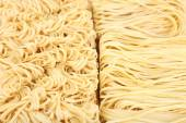 Different dry instant noodles close-up background — Stock Photo