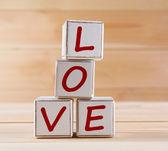 Love spelled in wooden blocks — Stock Photo
