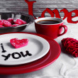 Cookie in form of heart on plate with inscription I Love You on color wooden table background — Stock Photo #64440561