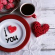 Cookie in form of heart on plate with inscription I Love You on color wooden table background — Stock Photo #64440589