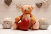 Teddy bear with candles — Stock Photo