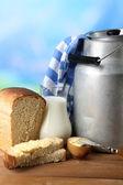 Retro can for milk with fresh bread — Stok fotoğraf