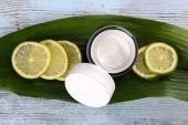 Cosmetic cream with slices of lime — Stock Photo
