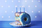 Delicious donuts with birthday candles — Zdjęcie stockowe