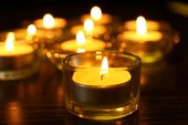 Burning candles on dark background — Stock Photo