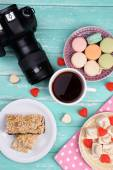 Different sweets and camera — Stock Photo