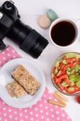 Delicious breakfast and camera — Stock Photo