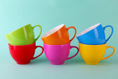 Colorful cups on color background — Stock Photo