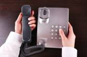 Female hand dialing number — Stock Photo