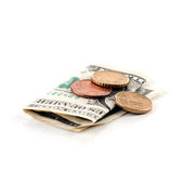 Paper money and coins — Stock Photo
