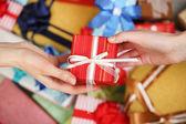 Female hands holding gift — Stock Photo