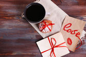 Love letters with coffee and cookies on wooden background — Stock fotografie