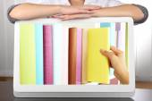 E-learning concept.  Digital library - books inside tablet — Stock Photo