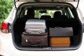 Suitcases and bags in trunk of car ready to depart for holidays — Stock Photo