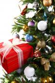Gift box on Christmas tree closeup — Stock Photo