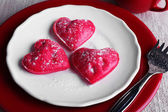 Cookies in form of heart in plate with cup of coffee on napkin background — Stock fotografie