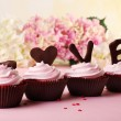 Delicious Valentine Day cupcakes on light background — Stock Photo #64940861