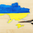 Map of Ukraine and scissors - concept of disintegration of the country — Stock Photo #64943819