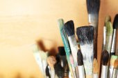 Different paintbrushes on wooden background — 图库照片