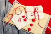 Love letters with red ribbon on wooden background — Stok fotoğraf