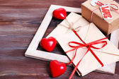 Love letters with gift on wooden background — Stok fotoğraf