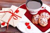 Love letters with coffee and cookies on wooden background — Fotografia Stock