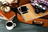 Vintage suitcase with camera — Stock Photo