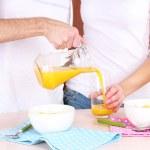 Couple has breakfast in kitchen — Stock Photo #65012679