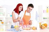 Happy couple preparing dough baking in kitchen — ストック写真