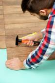 Carpenter worker installing laminate flooring in the room — Stock Photo
