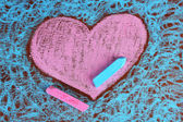 Heart drawn of chalks — Stock Photo