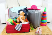 Suitcases packed with clothes — Stock Photo